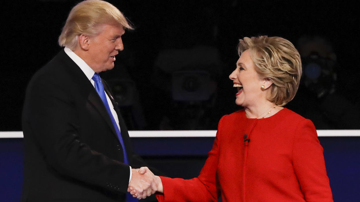 Republican presidential nominee Donald Trump shakes hands with Democratic presidential nominee Hillary Clinton after the presidential debate at Hofstra University.