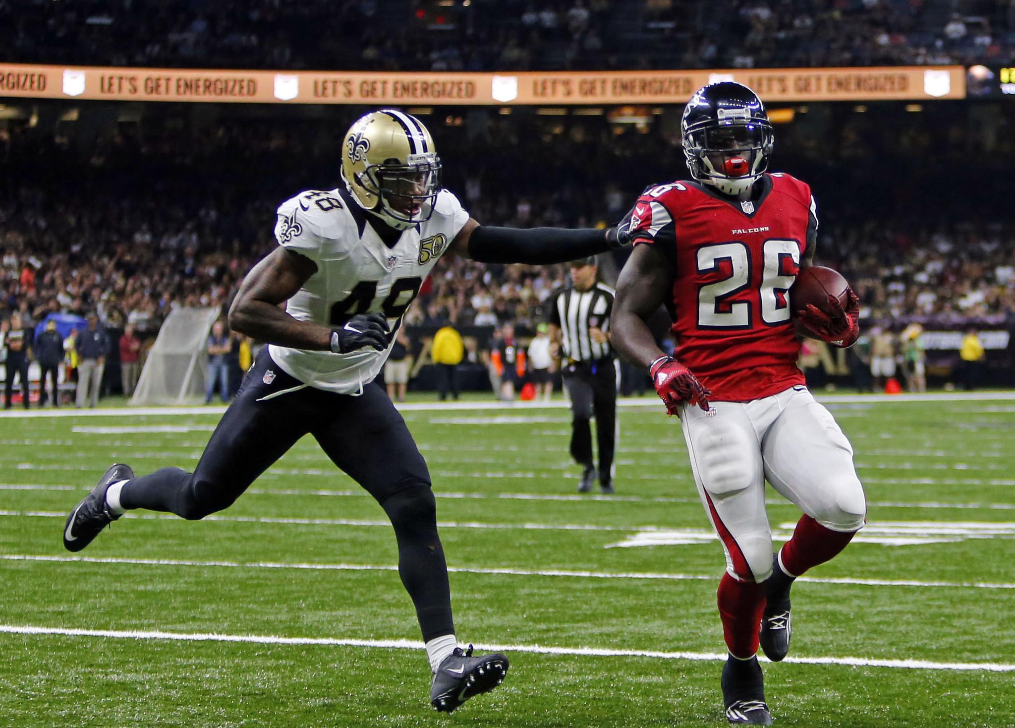 Running backs rush Falcons past Saints 45 32 LA Times