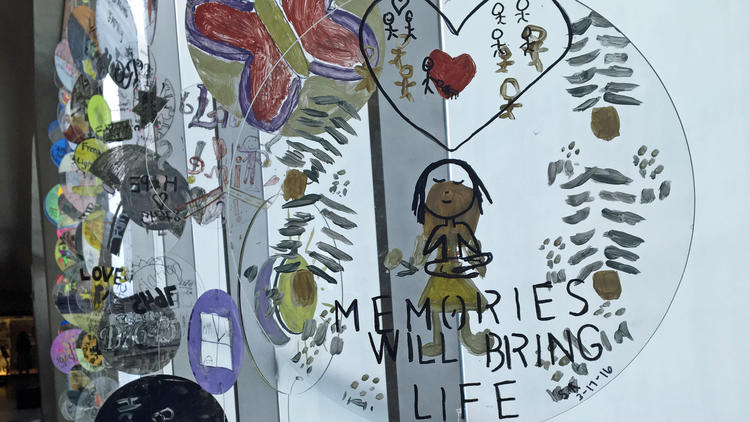 A student-made mobile inspired by the Share Our Stories program on view at the Museum of the Holocaust.