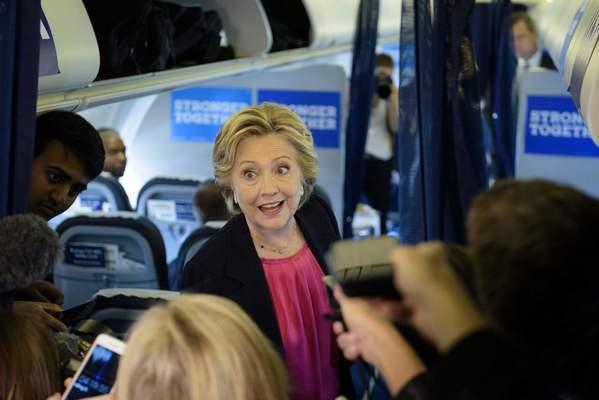 Hillary Clinton speaks to reporters on her plane on Tuesday. (Brendan Smialowski / AFP / Getty)