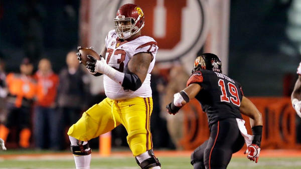 Trojans offensive tackle Zach Banner runs with the ball after receiving a lateral on the final play of a loss at Utah. (Rick Bowmer / Associated Press)