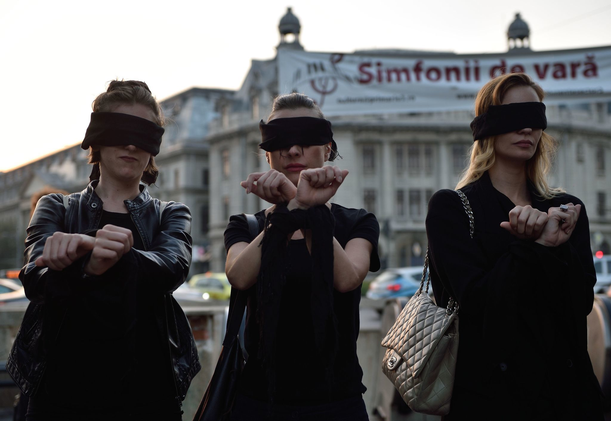 Romanian women in Bucharest show solidarity with Polish women protesting a proposed abortion law in Poland.