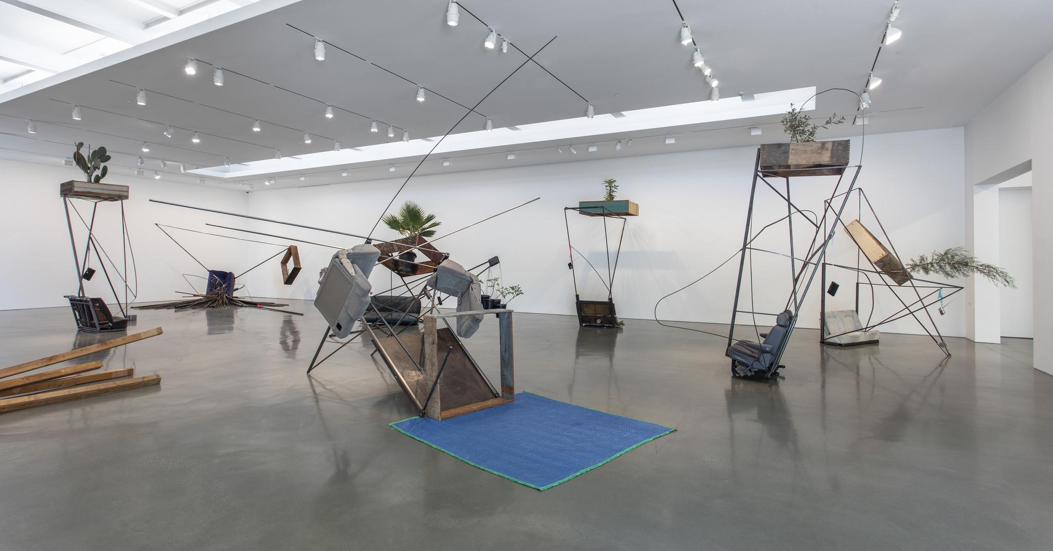 """Abraham Cruzvillegas' """"Autoconcancin"""" sculptures bulk up Calder's """"Circus"""" into a pumping iron gymnasium,"""
