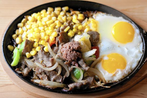 Steak and eggs travel the globe; we sample the results in Chicago ...