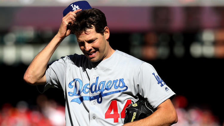 Dodgers starter Rich Hill exits Game 2 against the Nationals after giving up six hits and four runs Sunday. (Rob Carr / Getty Images)