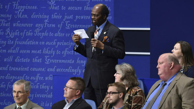 James Carter asks a question during the debate. (Paul J. Richards / AFP/Getty Images)