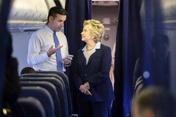 Hillary Clinton and her campaign's national press secretary, Brian Fallon, chat on Oct 3. (Associated Press)