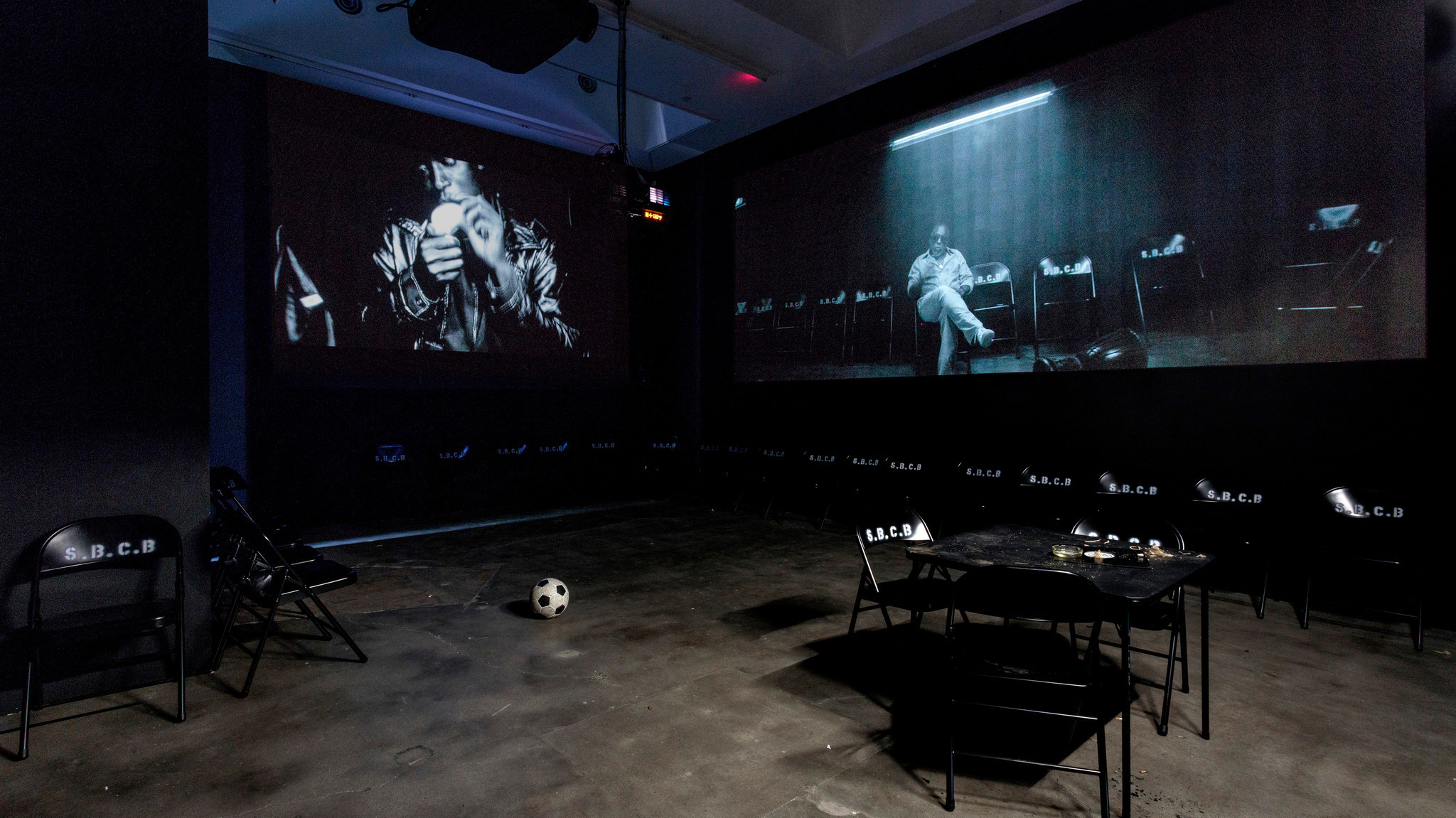 A view of Kahlil Joseph's filmic installation inside Henry Taylor's exhibition at Blum & Poe.