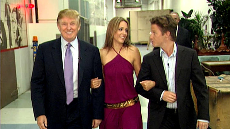 Donald Trump with Arianne Zucker and Billy Bush in 2005. (Getty Images)