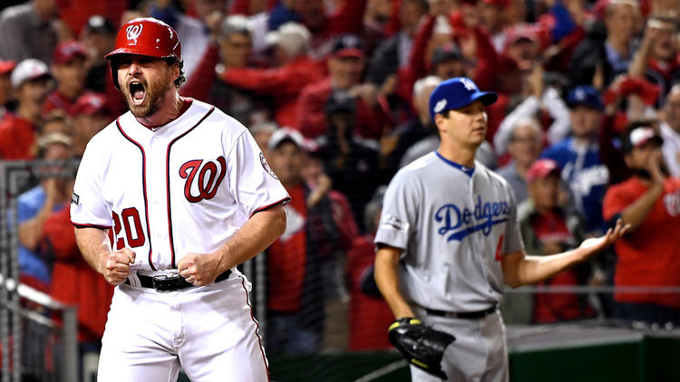 Nationals second baseman Daniel Murphy celebrates after scoring a run against the Dodgers and pitcher Rich Hill (background) in the second inning of Game 5 of the NLDS on Thursday in Washington. To see more images, click on the photo. (Wally Skalij / Los Angeles Times)