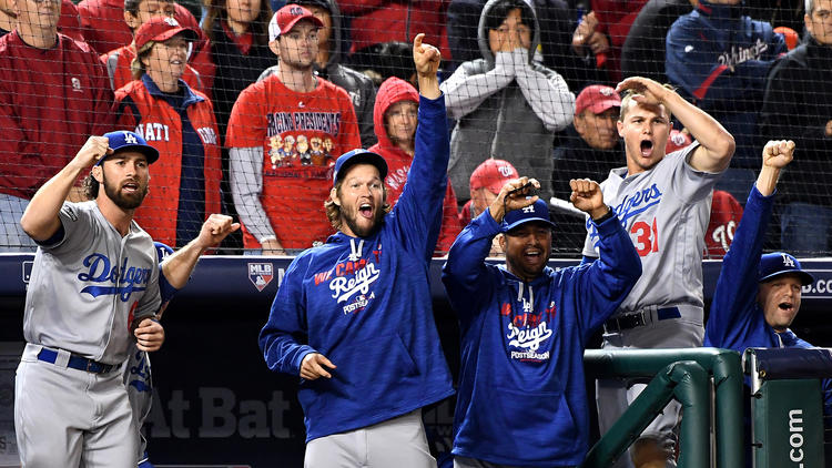 Dodger players and coaches celebrate after pinch-hitter Carlos Ruiz delivered a run-scoring single to take the lead over the Nationals in the seventh inning of Game 5. (Wally Skalij / Los Angeles Times)