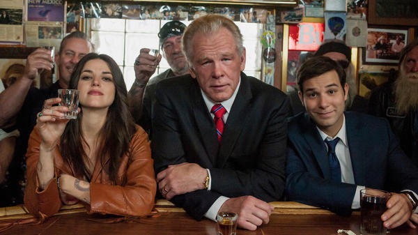 "Nick Nolte, center, plays an ex-president, while Callie Hernandez, left, is his new friend and Skylar Astin his keeper in ""Graves,"" an Epix comedy. (Lewis Jacobs /Epix/Lionsgate)"