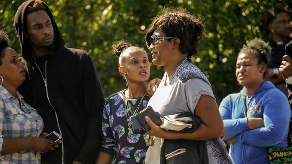 A woman who lost her husband in the shooting returns to the scene.