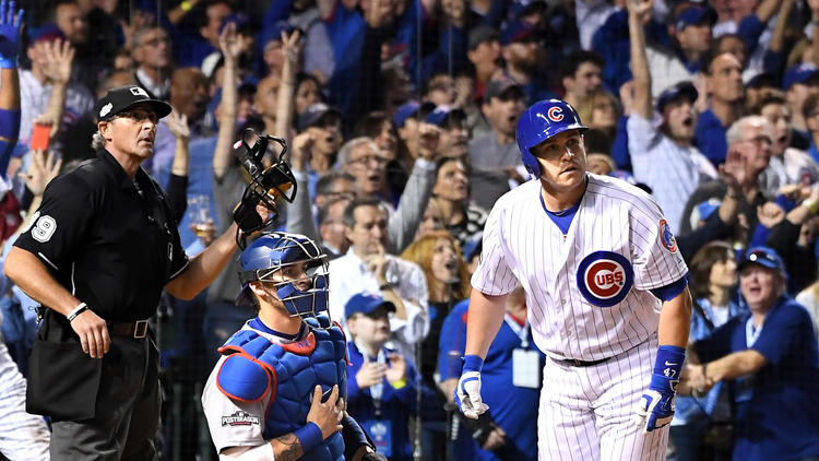 Cubs pinch-hitter Miguel Montero watches his grand slam head toward the right-field bleachers in the eighth inning of the NLCS opener on Saturday at Wrigley Field. (Wally Skalij / Los Angeles Times)