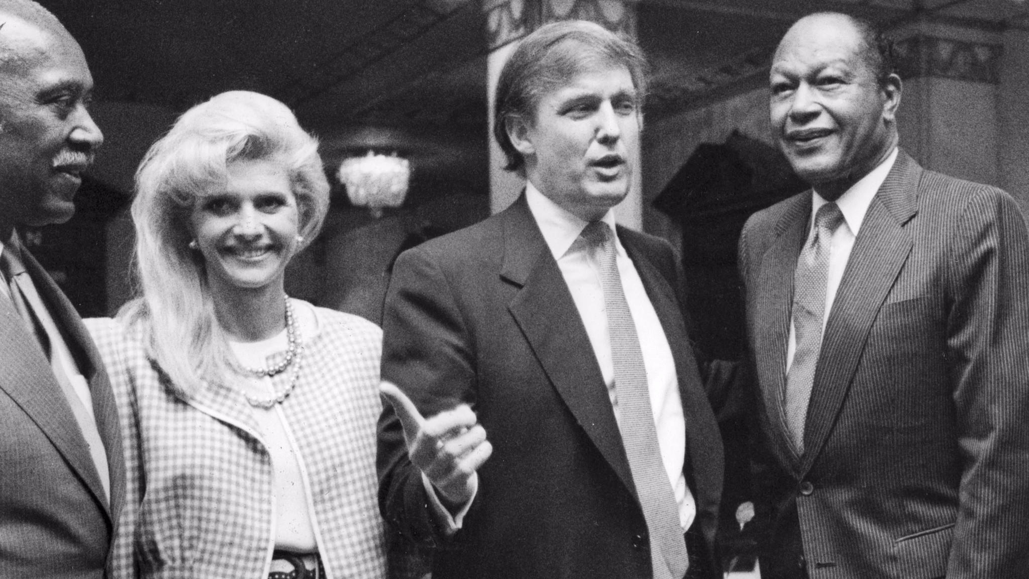 Nate Holden, left, Ivana Trump, Donald Trump and Tom Bradley in 1990. (Mindy Schauer / For The Times)