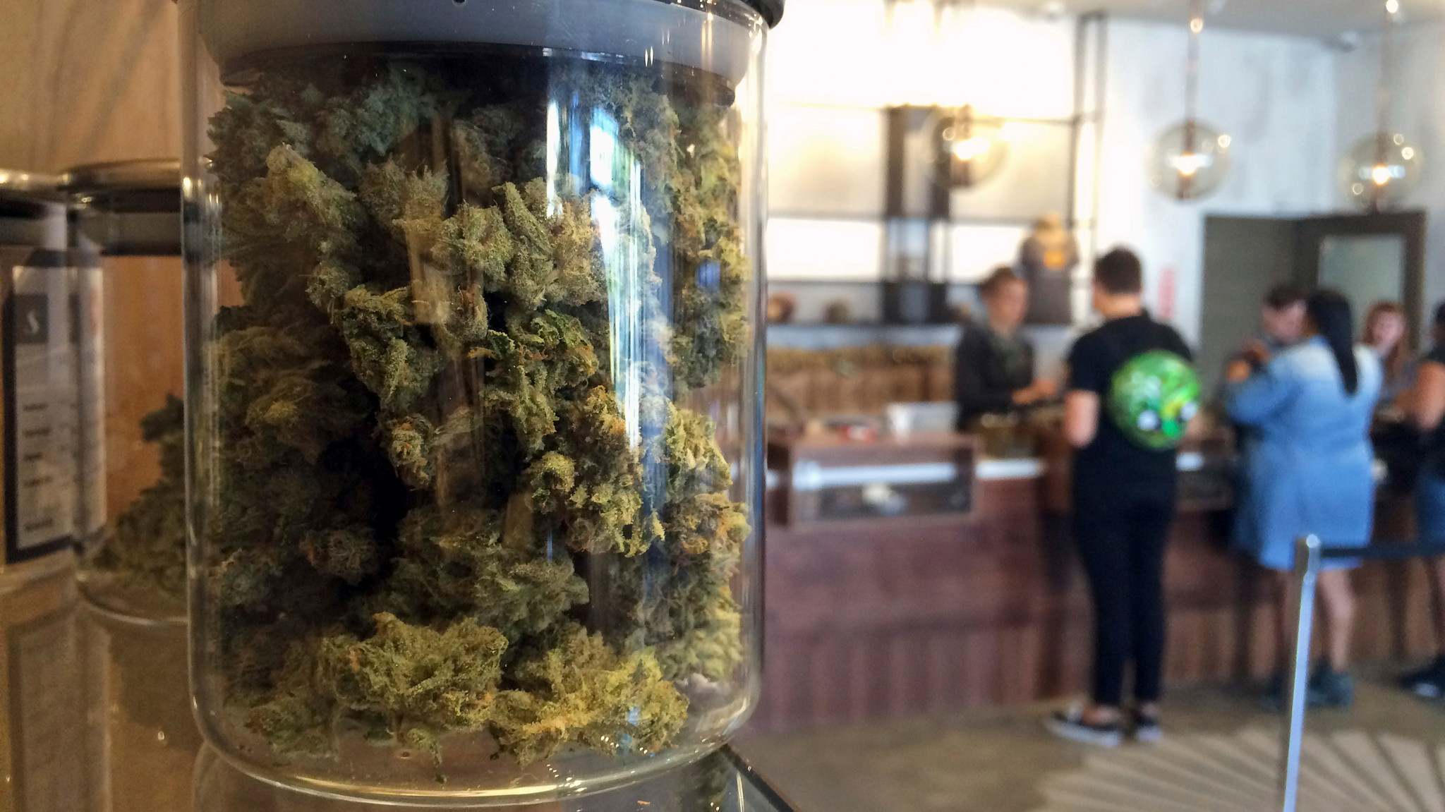 Customers buy products at a medical marijuana dispensary in San Francisco in April. (Haven Daley / Associated Press)
