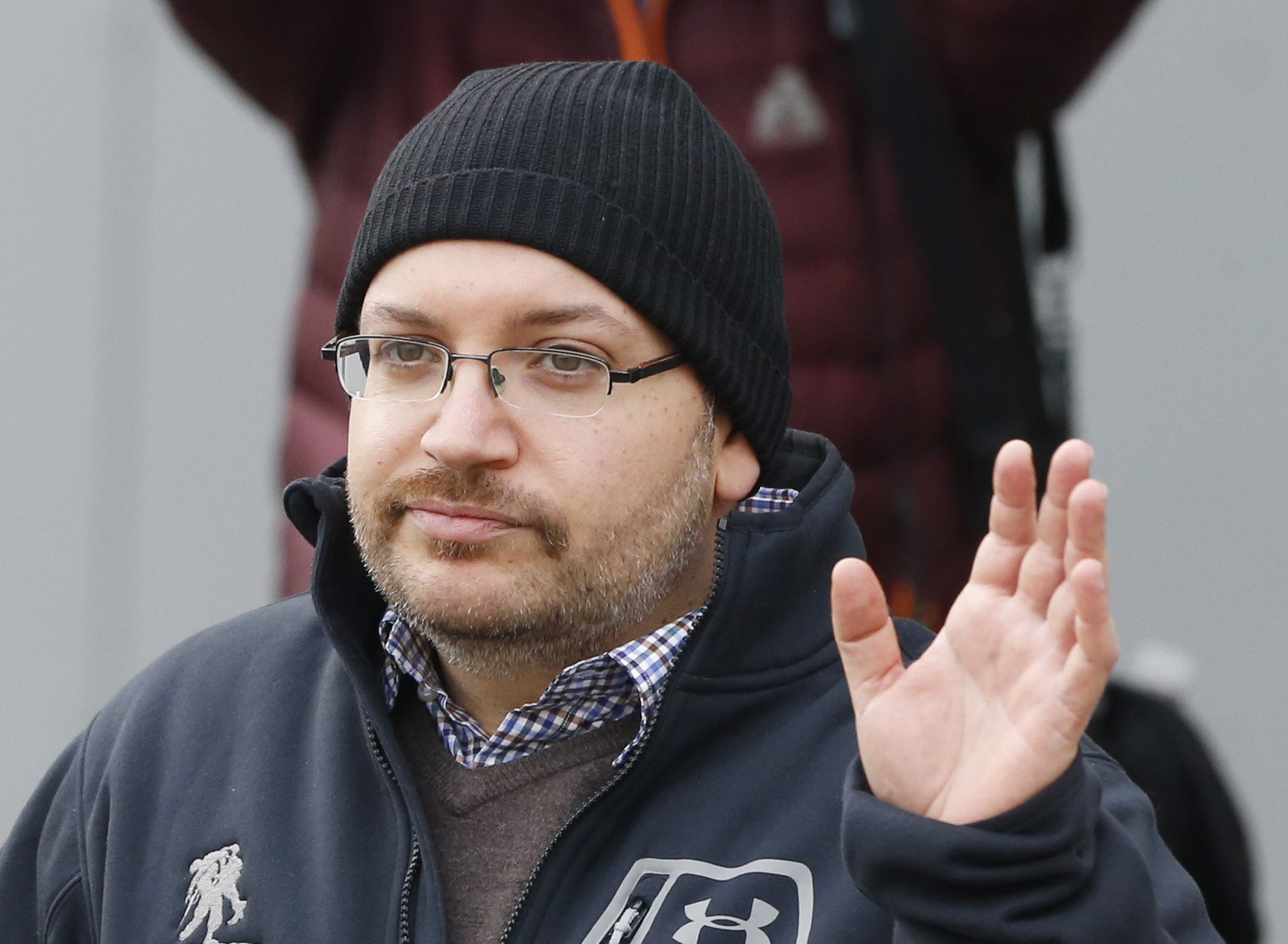 U.S. journalist Jason Rezaian waves to the media after arriving in Landstuhl, Germany, following his release from an Iranian prison on Jan. 20, 2016.