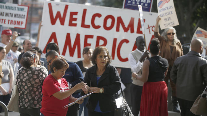 After thousands were sworn in as U.S. citizens Tuesday at the Los Angeles Convention Center, they were greeted by Hillary Clinton and Donald Trump supporters outside conducting voter registration drives. (Los Angeles Times)