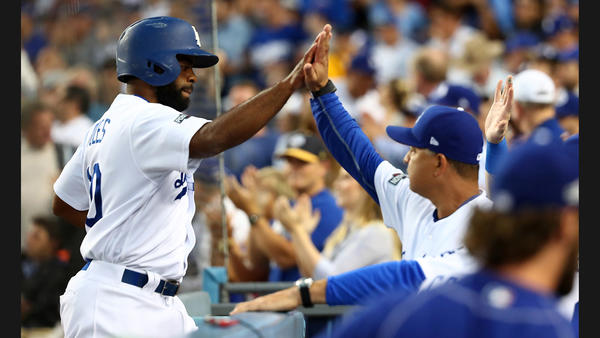 Andrew Toles is congratulated by manager Dave Roberts after scoring Dodgers first run. (Robert Gauthier / Los Angeles Times)