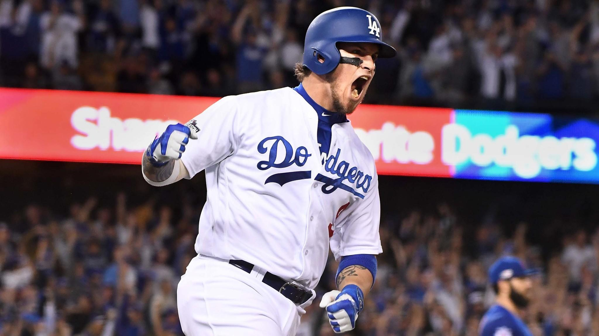 Yasmandi Grandal celebrates after hitting a two-run home run. (Wally Skalij / Los Angeles Times)