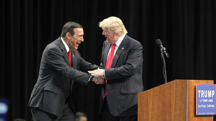 Rep. Darrell Issa, left, greets Donald Trump during a campaign rally in May.