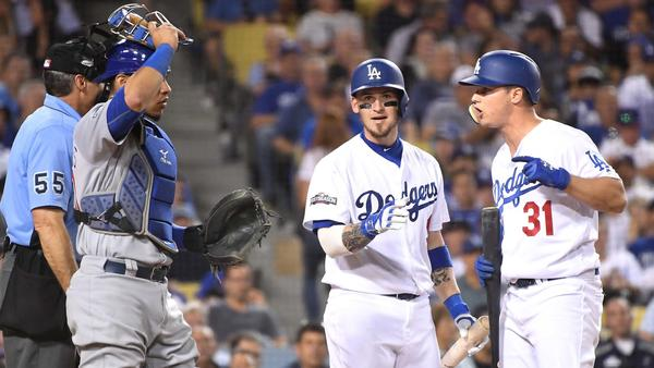 Dodgers Joc Pederson argues with  umpire Angel Hernandez on a strikeout as Yasmandi Grandal  tries to intervene. (Wally Skalij / Los Angeles Times)
