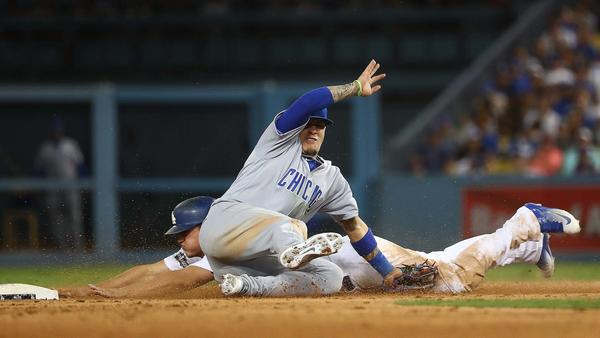 Corey Seager slides past Cubs second baseman Javier Baez on a steal attempt. (Robert Gauthier / Los Angeles Times)
