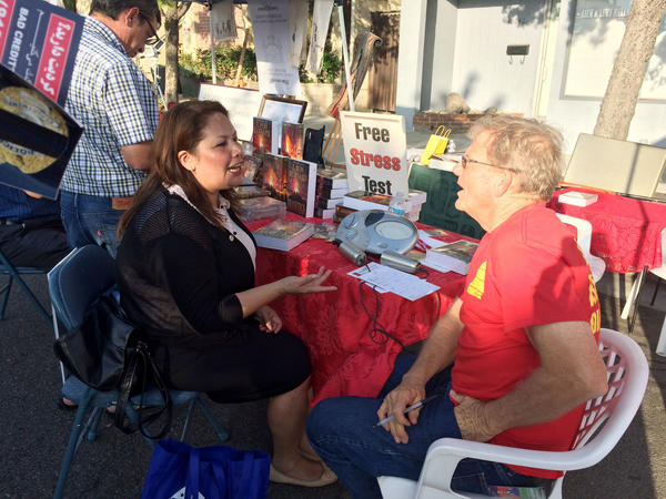 Assemblywoman Patty Lopez (D-San Fernando), left, campaigns at a local festival in Tujunga.