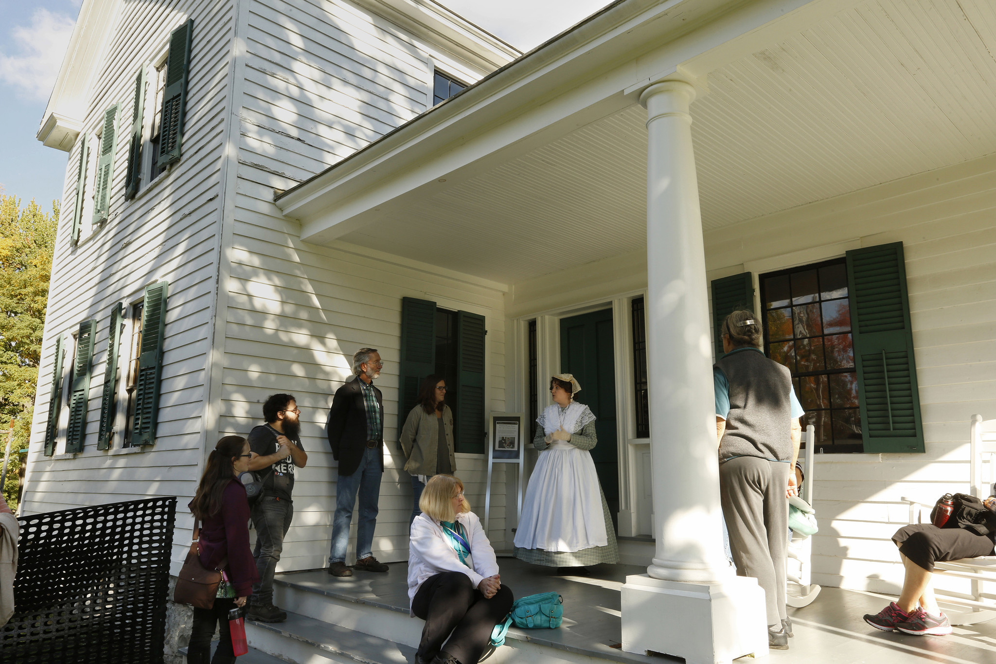 Melinda Grube (in costume) is an historical interpreter, who often appears as Elizabeth Cady Stanton, educating visitors about the role Stanton played in pushing for equal rights for women. Here she speaks to visitors at the park's Elizabeth Cady Stanton Home.