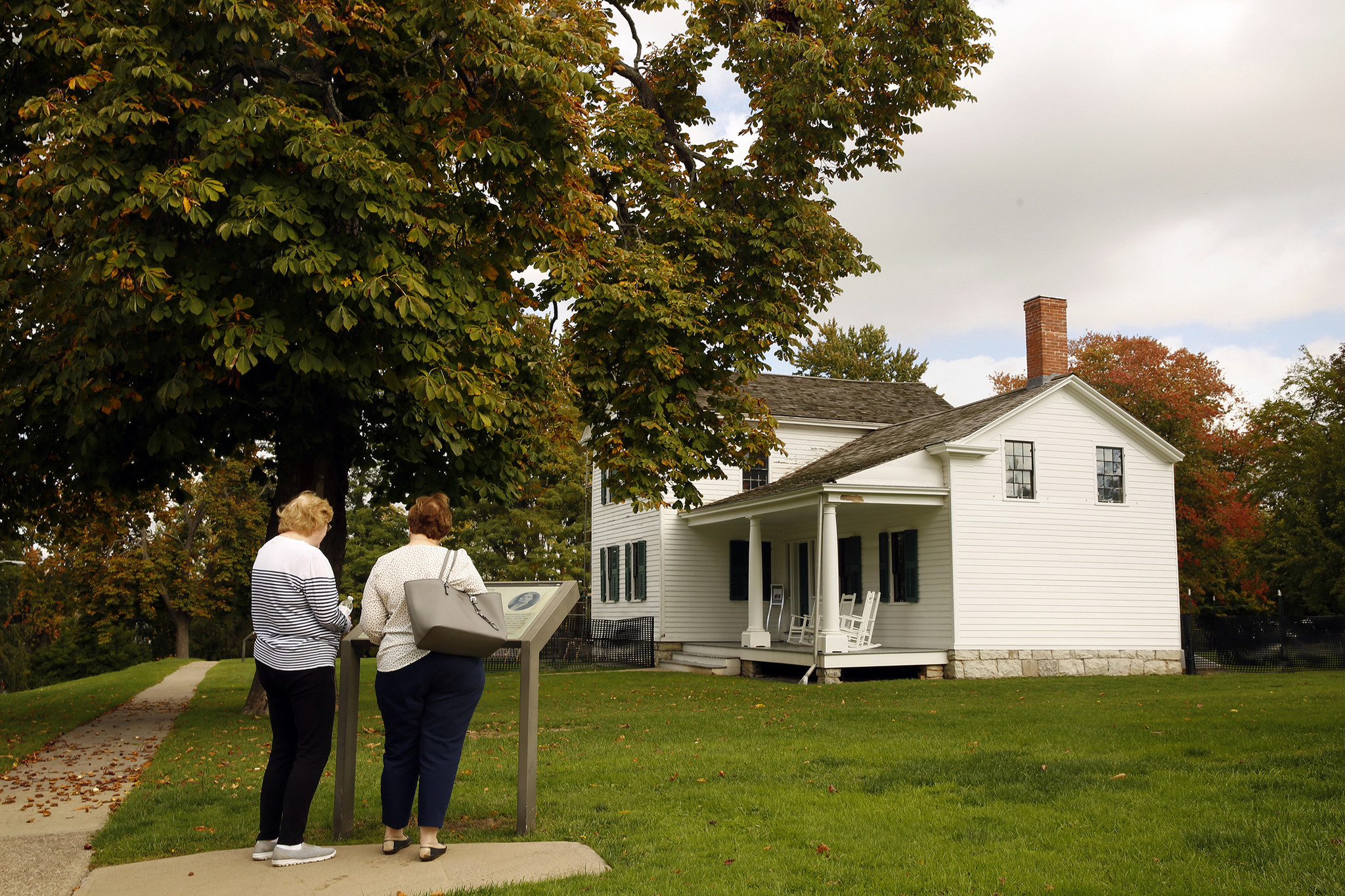 Visitors read about the Elizabeth Cady Stanton Home.