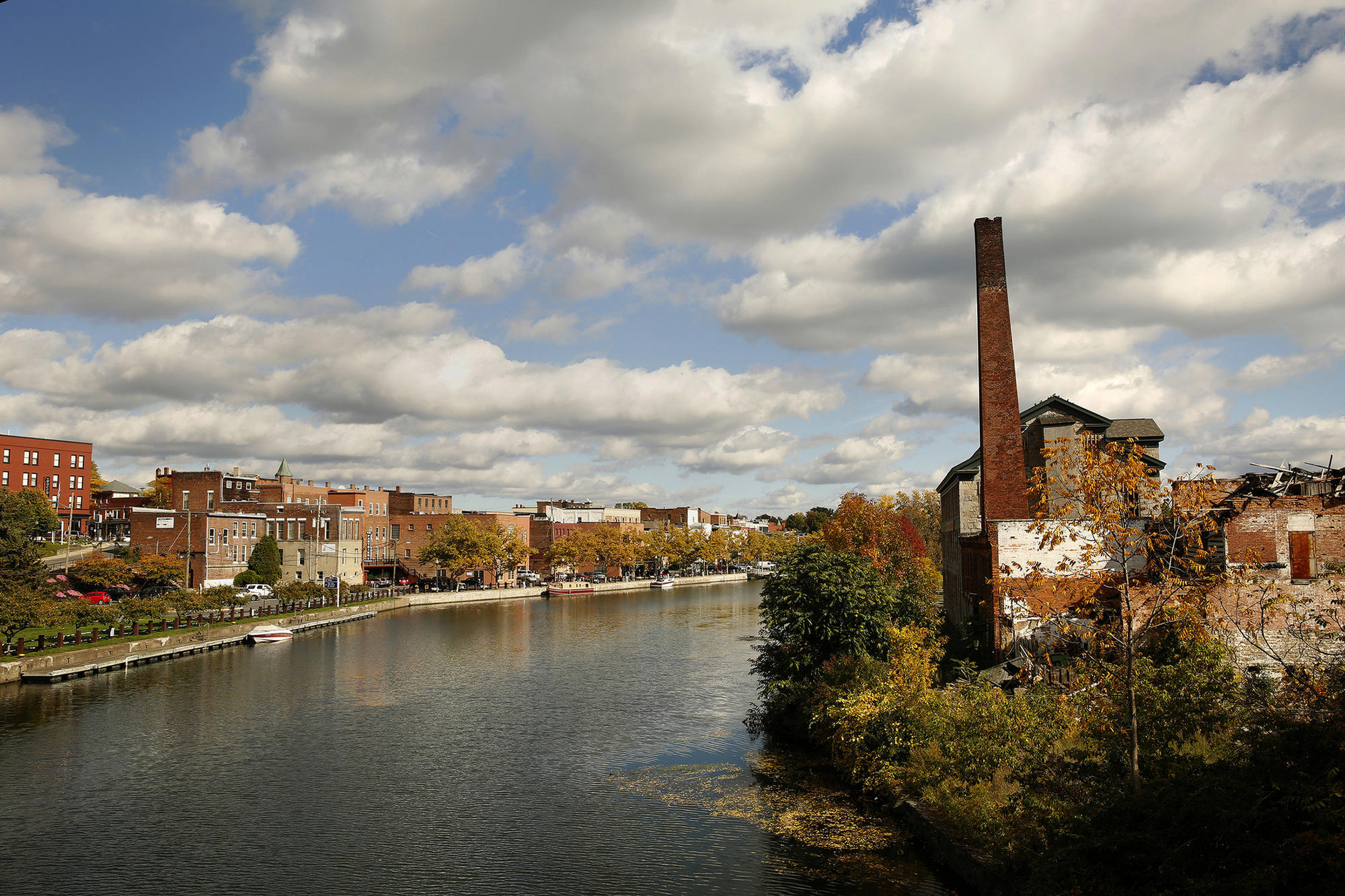 The Cayuga-Seneca Canal is part of the Erie Canalway, seen from Seneca Falls. The historic mill, right, will be the new site of the National Women's Hall of Fame. (Carolyn Cole / Los Angeles Times)