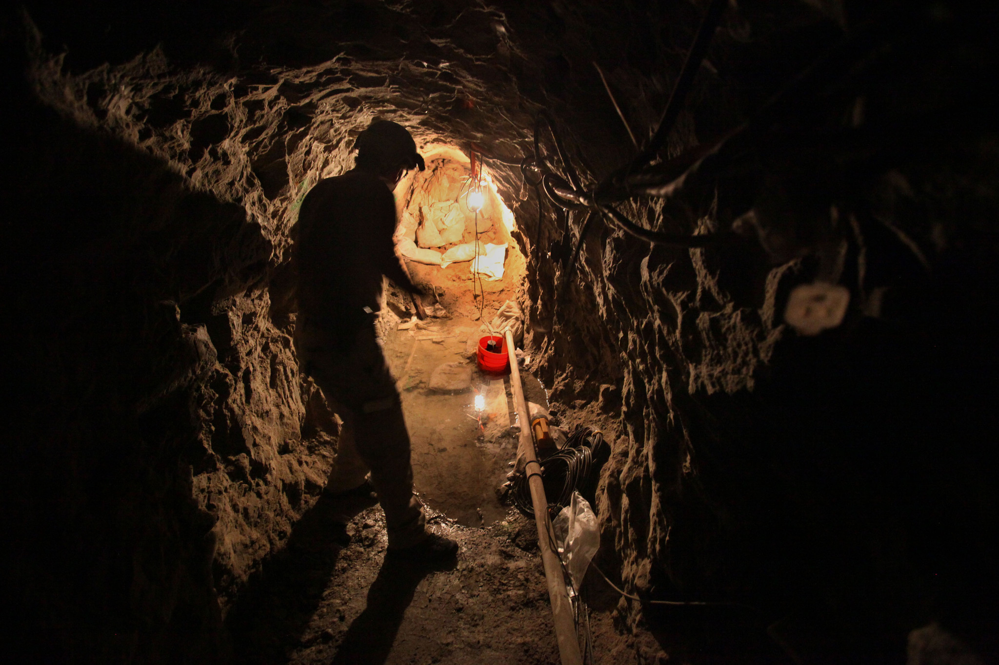 Lance LeNoir of the Border Patrol's Tunnel Rat team, walks to the end of the Galvez tunnel, which came north from a warehouse in Tijuana, near Otay Mesa.