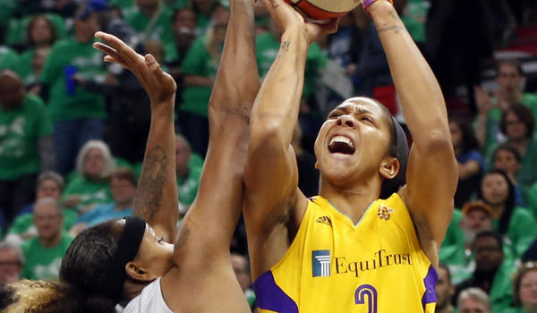 Sparks' Candace Parker, right, attempts to shoot over Minnesota Lynx's Rebekkah Brunson in the first quarter during Game 5 of the WNBA basketball finals Thursday. (Jim Mone / Associated Press)