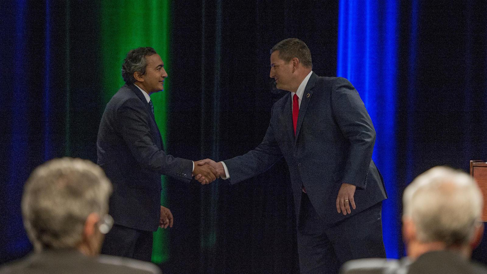 Democratic U.S. Rep. Ami Bera shakes hands with his Republican challenger, Sacramento County Sheriff Scott Jones. (Jose Luis Villegas / Associated Press)