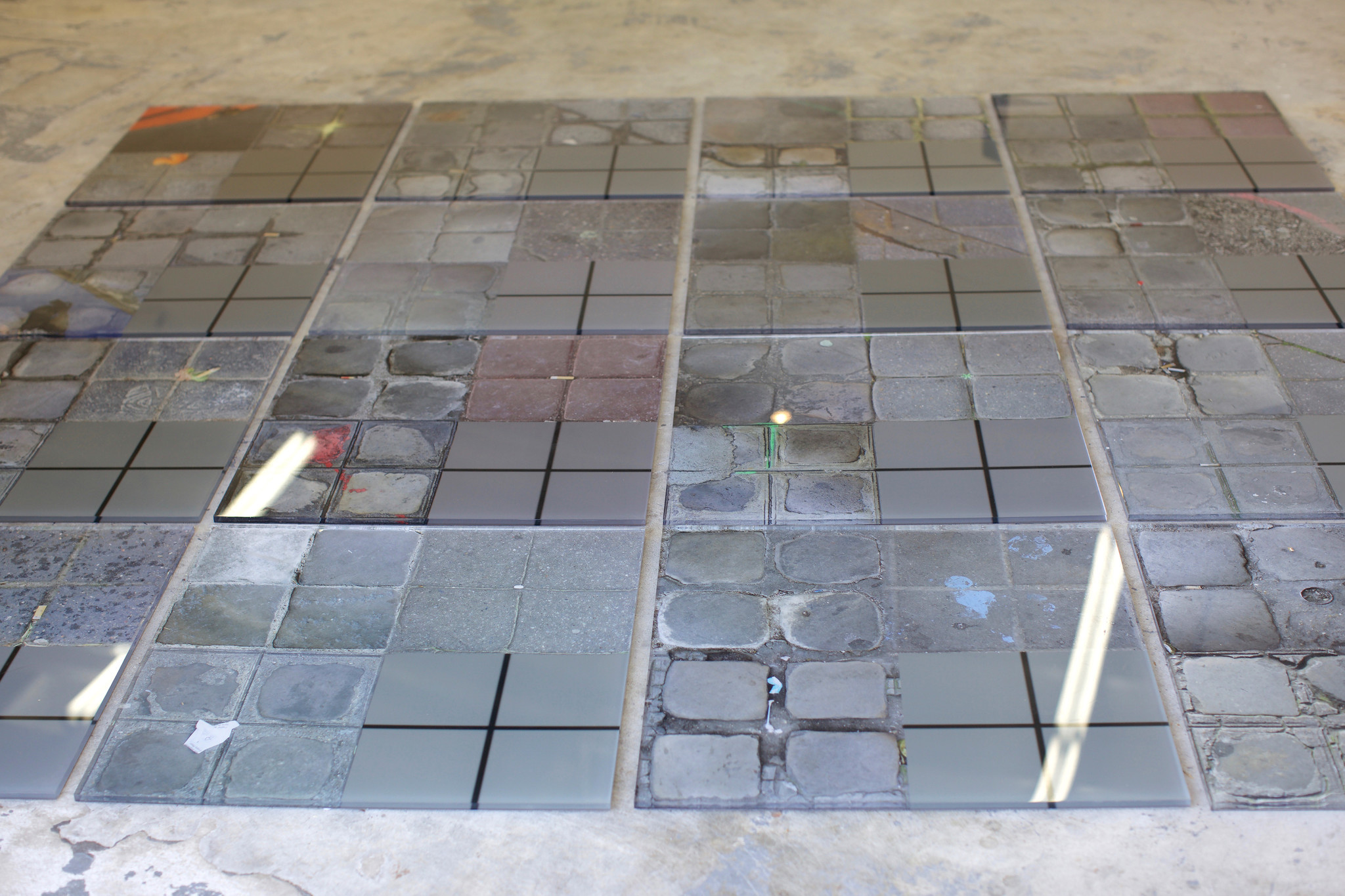 """Kenneth Morehouse's """"Impressions of Stone,"""" 2015, digital photographs back-printed on plexiglass, 94 by 94 inches."""