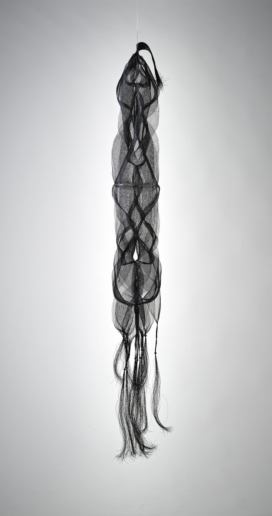 "Kay Sekimachi's ""Nagare I,"" 1967; black nylon monofilament, wood beads, plastic tubing; double, quadruple and tubular weave; 69 inches long, 13 inches diameter."