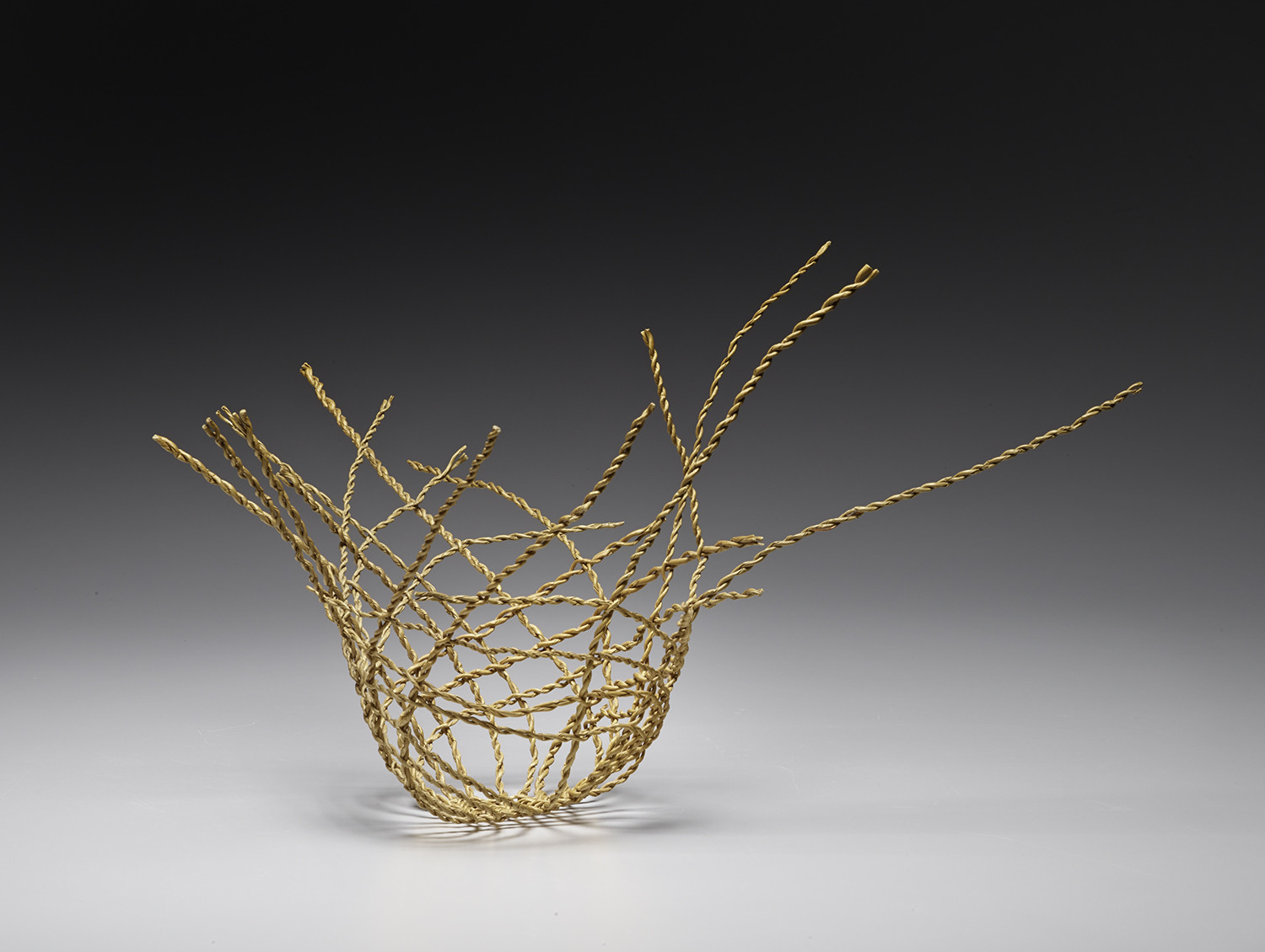"Kay Sekimachi's ""Untitled Basket,"" 1976 grass twine, split-ply braiding 8.5 x 16 x 11 inches"