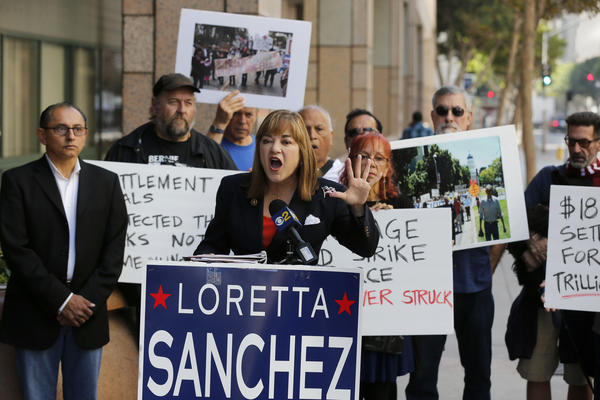 """Senate candidate Rep. Loretta Sanchez speaks at a news conference to """"expose the failure of the mortgage settlement made by Atty. Gen. Kamala Harris"""" on Oct. 26 in Los Angeles. (Allen J. Schaben / Los Angeles Times)"""