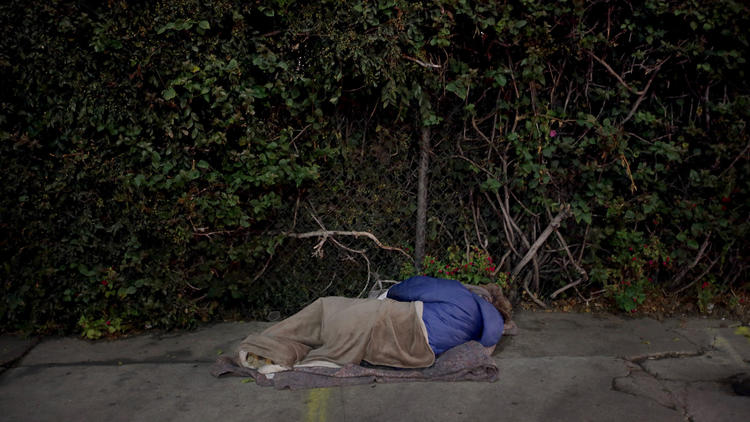 "Rachel ""Raquel"" Phillips sleeps at Highland and Franklin, one of the busiest intersections in Hollywood."