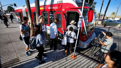Passengers board a Metro Rapid Bus on Vermont Avenue in South Los Angeles. Under the Measure M expenditure plan, the bus line would see rail-esque upgrades, which could include bus-only lanes, faster speeds and more limited stops.