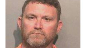 Scott Michael Greene, 46, is being held in the shooting deaths of two Des Moines-area police officers.