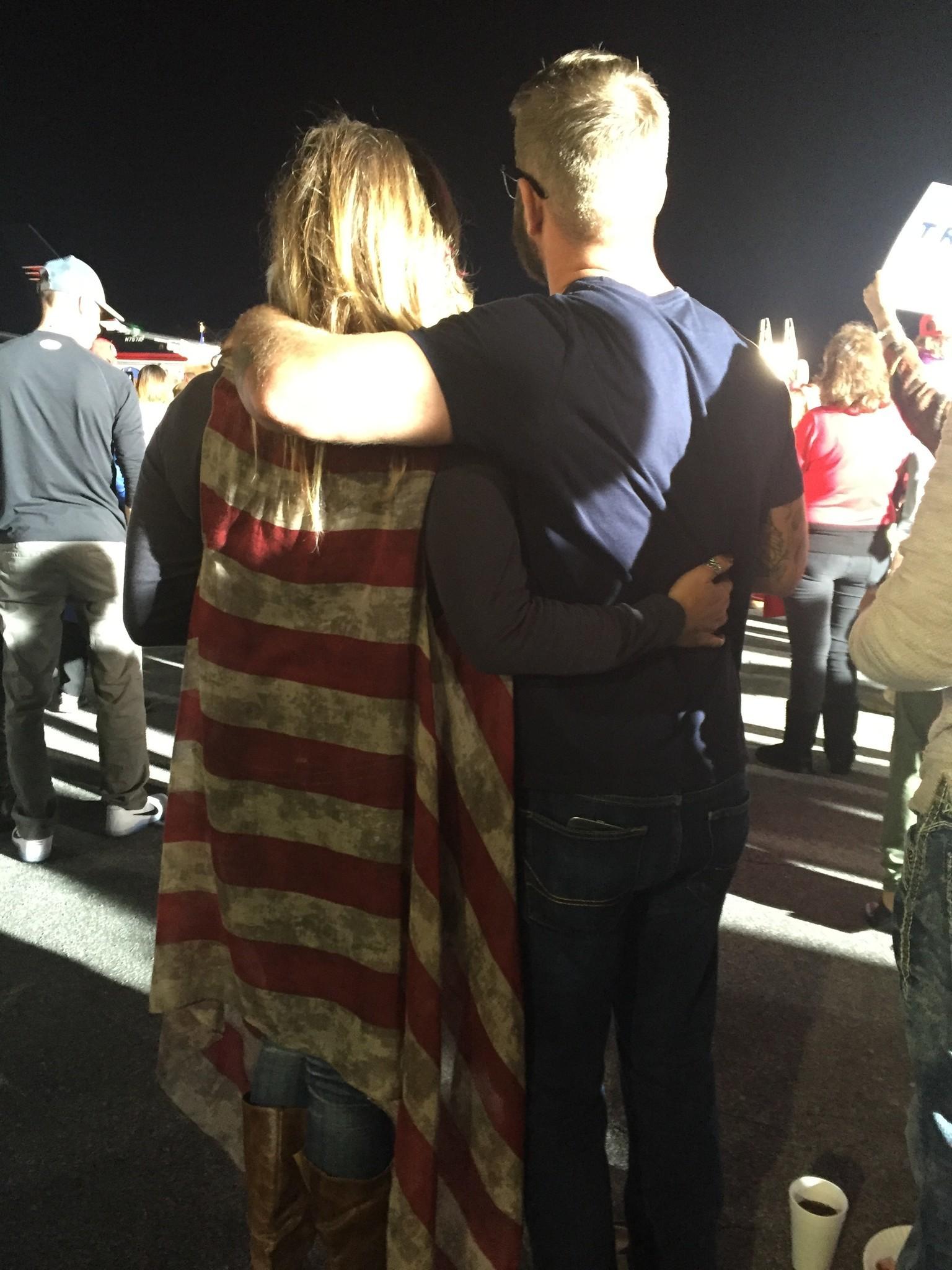 Shauna Godwin, left, wear a flag-themed sweater at a Trump rally in Kinston, N.C.