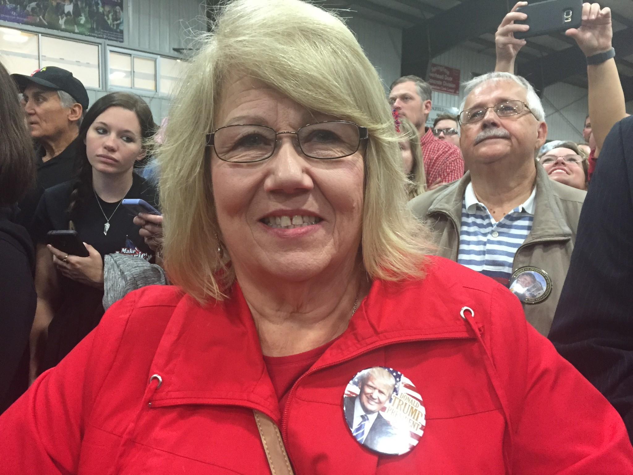 Stephanie Moore sports a Donald Trump button at a rally in Springfield, Ohio.