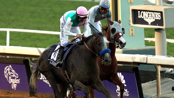 Arrogate, with jockey Mike Smith aboard, wins the Breeders' Cup Classic over California Chrome and Victor Espinoza. (Joe Scarnici / Getty Images)