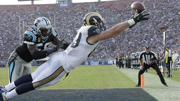 Rams tight end Tyler Higbee stretches out to catch, but misses, a pass in the end zone while he's defended by Panthers linebacker Thomas Davis during the second half. To see more images from the game, click on the photo above. (Robert Gauthier / Los Angeles Times)