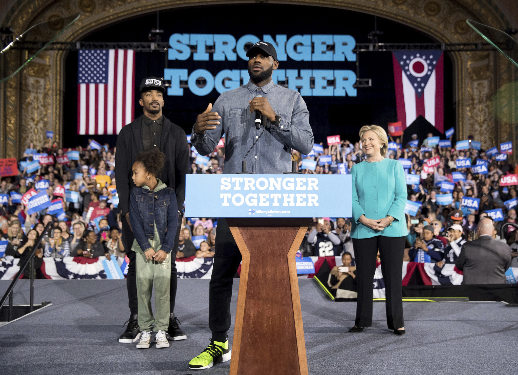 LeBron James, center, accompanied by Cleveland Cavaliers teammate J.R. Smith, left, and his daughter Demi, joined Hillary Clinton at a rally at the Cleveland Public Auditorium on Nov. 6.