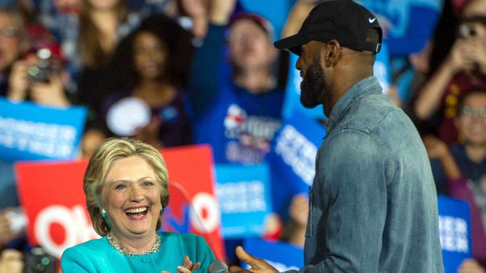Hillary Clinton in Cleveland with LeBron James on Sunday. (Phil Long / Associated Press)
