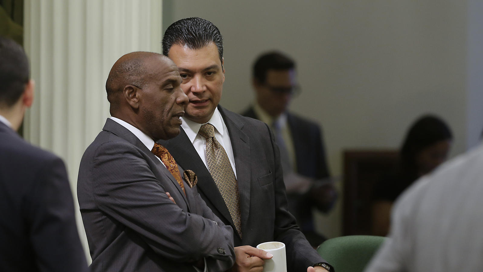 State Sen. Steven Bradford, left, shown talking to Secretary of State Alex Padilla, won a change to sentencing laws Wednesday. (Rich Pedroncelli / Associated Press)
