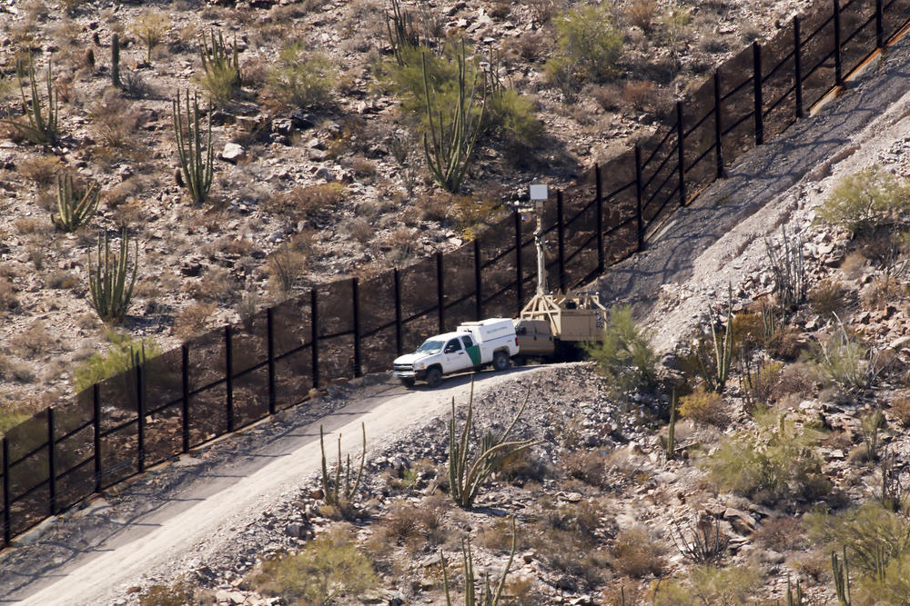 U.S. Customs and Border Protection vehicles man the metal border fence with trucks, cameras and regular patrols in the park.