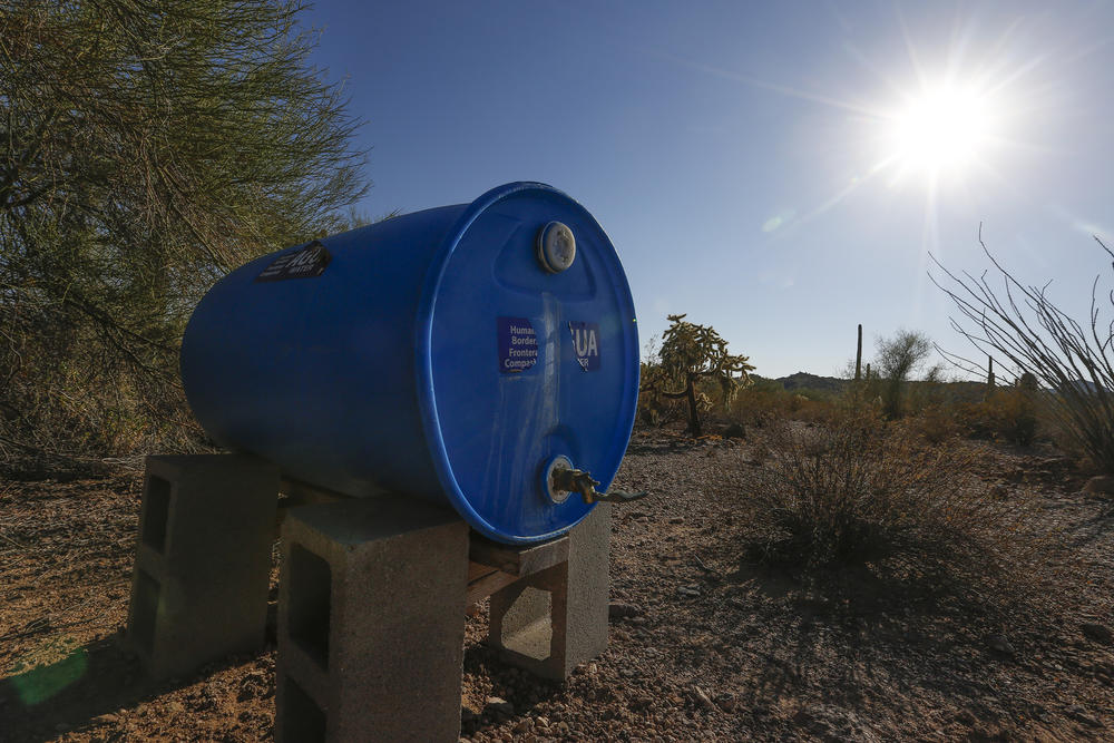 Humanitarian groups have placed blue tanks of water to aid immigrants crossing the desert in Organ Pipe National Monument.